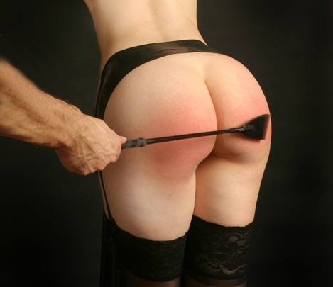 Riding crop on a bare bottom
